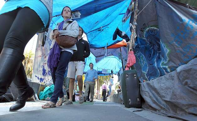 Tourists walk through a tunnel made of tents and tarps at Occupy San Francisco in Justin Herman Park Thursday Oct 27, 2011. Photo: Lance Iversen, The Chronicle