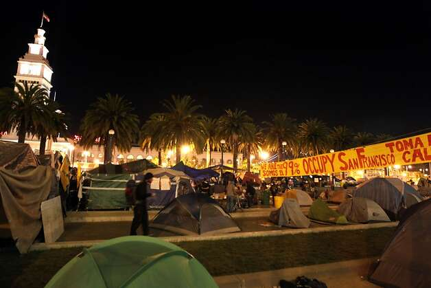 The San Francisco Ferry Building towers over a tent city at Occupy San Francisco in Justin Herman Park Thursday night Oct 27, 2011. Photo: Lance Iversen, The Chronicle