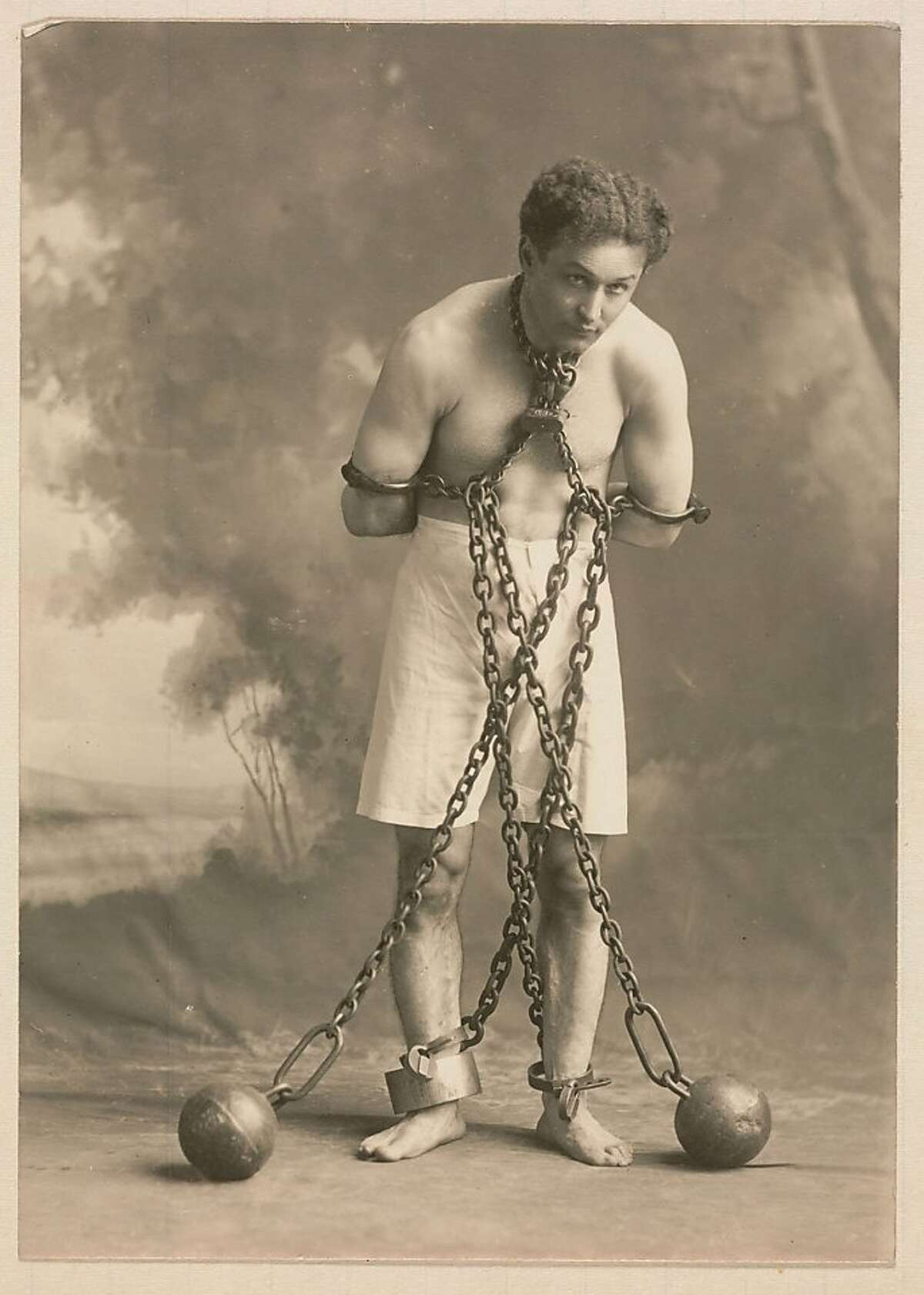 Unidentified Artist, Studio photograph of Houdini in White Trunks and Chains, c. 1905, modern photograph from historic print. Courtesy of the Harvard Theatre Collection, Houghton Library, Cambridge, Massachusetts.