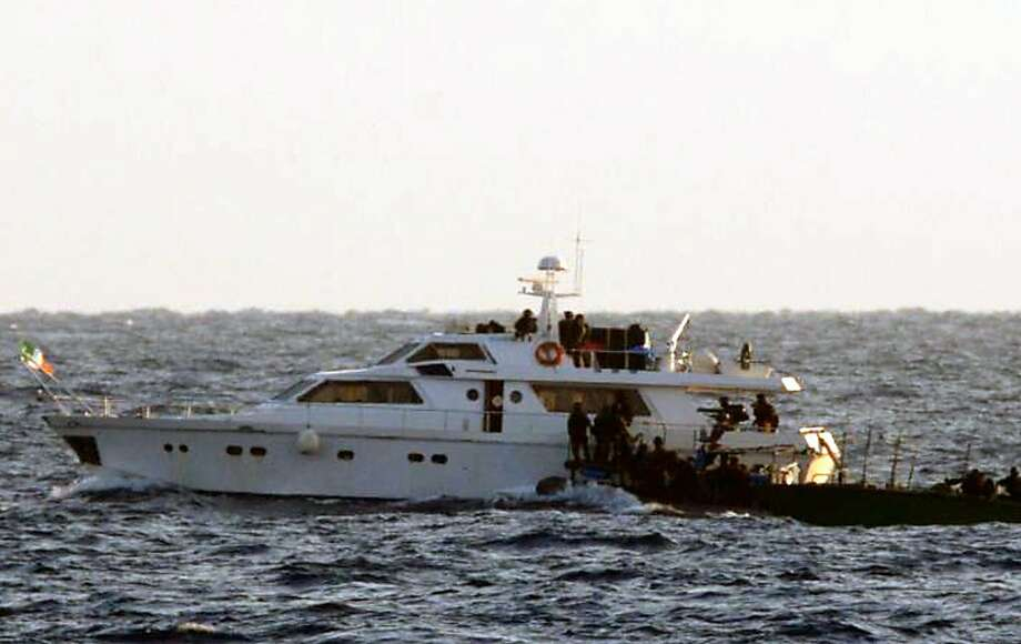 In this photo released by the Israeli Defense Forces on Friday, Nov. 4, 2011, in the Mediterranean Sea,  Israeli security boards on of the two protest boats on their way to Gaza in attempt to break Israel's blockade of the Palestinian territory.  Israel's military said Friday the navy has boarded two protest boats and it will tow them to the Israeli port of Ashdod. (AP Photo/ IDF)  EDITORIAL USE ONLY Photo: AP
