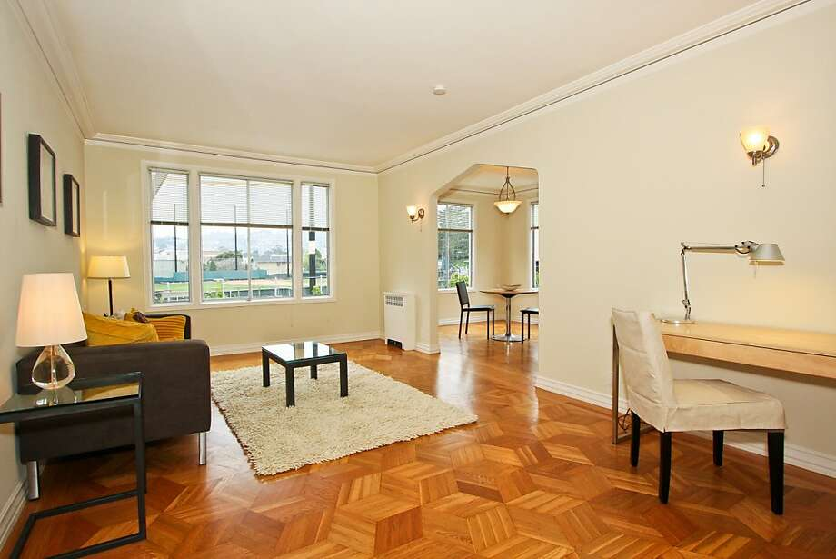 The living room at 2240 Golden Gate Photo: Trinity Management Services