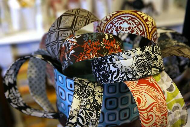 Daughter Melinda Brown of Mo, Jo & Zoe clothing and accessories in Truckee, Calif., shows cloth covered headbands that don't pinch on Friday, October 14, 2011. Photo: Liz Hafalia, The Chronicle