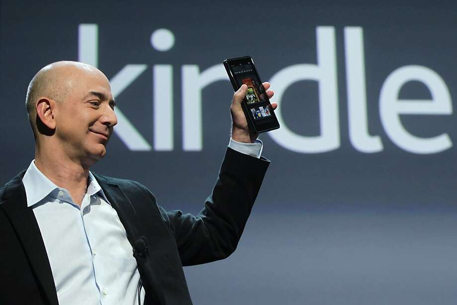 NEW YORK, NY - FILE:  Amazon founder Jeff Bezos holds the new Amazon tablet called the Kindle Fire on September 28, 2011 in New York City. According to reports October 25, 2011, Amazon's profits dropped 73 percent over the same quarter last year citing spending on new tablets and long term projects.  (Photo by Spencer Platt/Getty Images) Photo: Spencer Platt, Getty Images