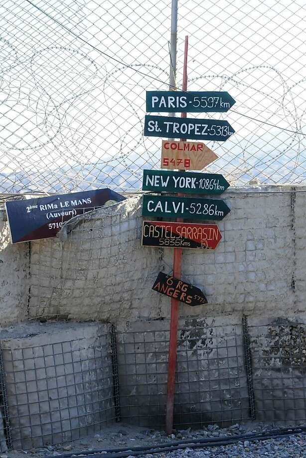 In this picture taken on October 14 , 2011 Sign of cities seen at the Torah base in the district of Surobi, about 50 kms (30 miles) east of Kabul. The first 200 French soldiers were due to leave Afghanistan on October 19 as part of an early withdrawal of troops announced in July by President Nicolas Sarkozy. A further 200 soldiers are due to return to France before Christmas, with another 600 leaving in 2012 ahead of a full drawdown of NATO's combat mission in 2014. AFP PHOTO/ Aymeric VINCENOT (Photo credit should read AYMERIC VINCENOT/AFP/Getty Images) Photo: Aymeric Vincenot, AFP/Getty Images