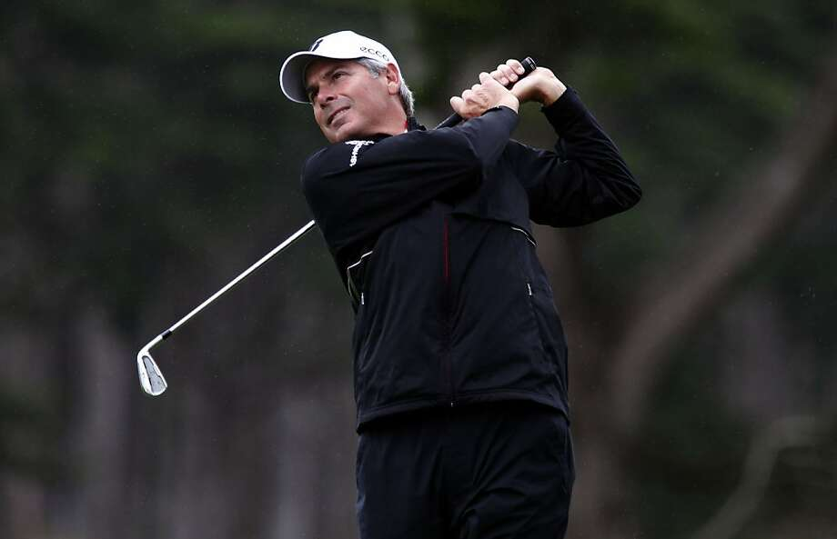 Co-leader at 3 under par, Fred Couples hits a shot to the 10th green, as round one of the Charles Schwab Cup gets underway at TPC Harding Park  in San Francisco, Ca. on Thursday November 03, 2011. Photo: Michael Macor, The Chronicle