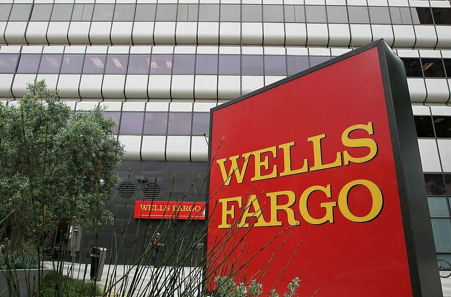 OAKLAND, CA - JULY 19:  A sign is posted in front of a Wells Fargo Bank branch on July 19, 2011 in Oakland, California.  San Francisco-based Wells Fargo & Co. reported a 30 percent surge in quarterly profits with earnings of $3.73 billion, or 70 cents per share compared to $2.88 billion, or 55 cents per share one year ago.  (Photo by Justin Sullivan/Getty Images)  Ran on: 08-06-2011 Wells Fargo hasn't been notifying heirs of their right to purchase properties, a group lawsuit says. Photo: Justin Sullivan, Getty Images