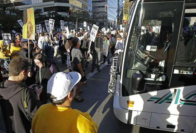 Occupy Oakland protesters block the passage of a transit bus Wednesday, Nov. 2, 2011, in Oakland, Calif. Oakland's citywide general strike, a hastily planned and ambitious action called by Occupy protesters a day after police forcibly removed their City Hall encampment last week,  seeks to shut down the Port of Oakland. (AP Photo/Ben Margot) Photo: Ben Margot, AP