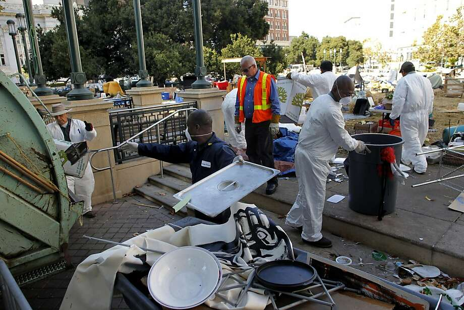 Clean up of Frank Ogawa Plaza in front of city hall, continues as the  Occupy Oakland protesters were forced out early this morning, along with their encampment being dismantled in Oakland, Ca., on Tuesday October 25, 2011. Photo: Michael Macor, The Chronicle