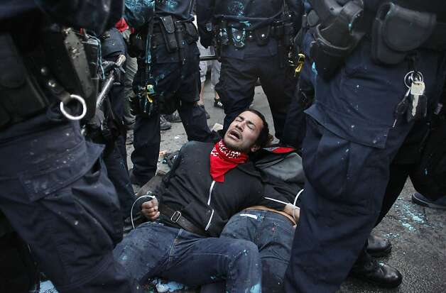A protester is placed under arrest, as officers take up a position on Washington and 8th streets, while the  Occupy Oakland protesters continue their cause as they march along the streets of downtown Oakland, Ca., on Tuesday October 25, 2011. Photo: Michael Macor, The Chronicle