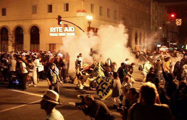 Police fire tear gas into the crowd of Occupy Oakland protesters who filled the intersection of Broadway and 14th, when they failed to clear the area,  in front of city hall in Oakland, Ca., on Tuesday October 25, 2011. Photo: Michael Macor, The Chronicle