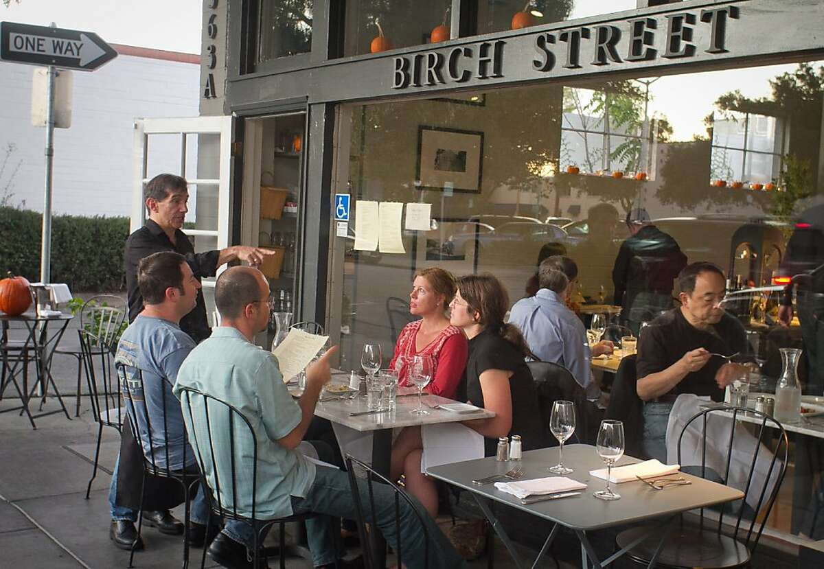 Diners enjoy dinner outside at Birch St. Restaurant in Palo Alto, Calif., on Saturday, October 29, 2011.