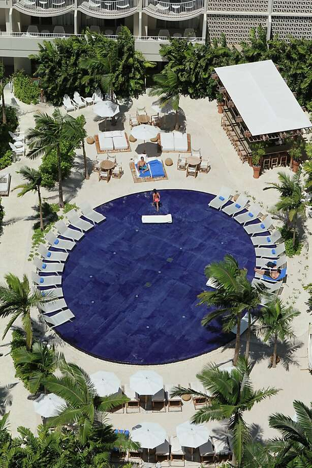 The Private Sunset Beach is a pool area at Modern Honolulu with palms, real sand and a circular wading pool with custom-designed Yves Klein blue glass tiles. Photo: Spud Hilton, The Chronicle