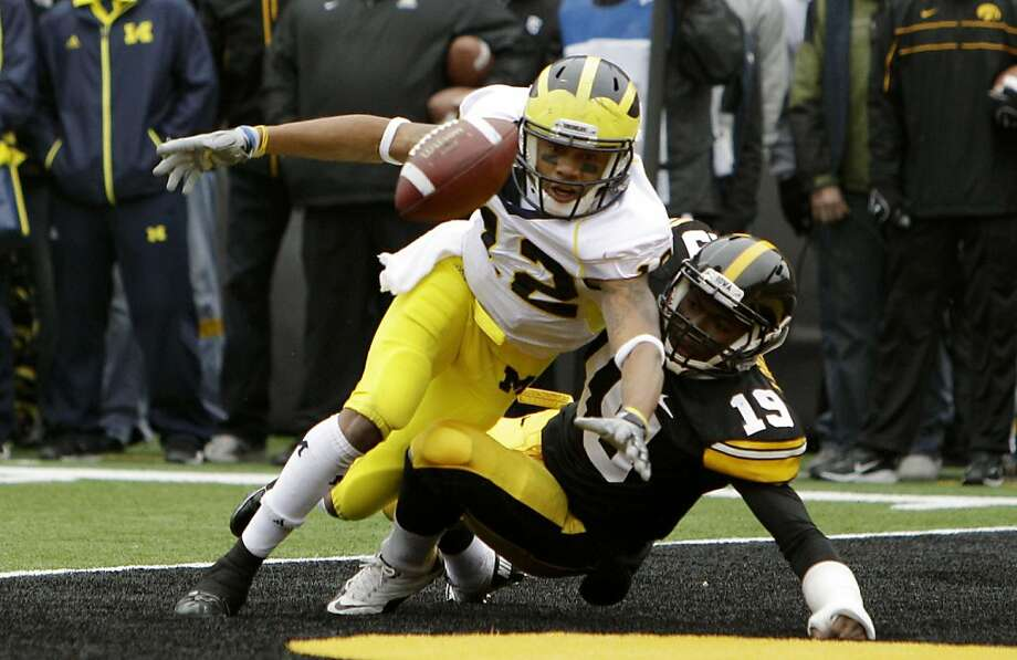 Iowa defensive back B.J. Lowery (19) breaks up a pass  in the end zone intended for Michigan wide receiver Roy Roundtree on the final play of the game in an NCAA college football game, Saturday, Nov. 5, 2011, in Iowa City, Iowa. Iowa held on to win 24-16.  (AP Photo/Charlie Neibergall)  Ran on: 11-06-2011 B.J. Lowery (right) preserves Iowa's win by breaking up this pass intended for Michigan's Roy Roundtree. Ran on: 11-06-2011 B.J. Lowery (right) preserves Iowa's win by breaking up this pass intended for Michigan's Roy Roundtree. Ran on: 11-06-2011 B.J. Lowery (right) preserves Iowa's win by breaking up this pass intended for Michigan's Roy Roundtree. Photo: Charlie Neibergall, AP