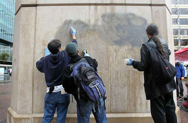 Members of Occupy Oakland and concerned citizens pitch in to clean up graffiti on a Bart elevator next to Frank Ogawa Plaza in downtown Oakland Thursday, November 3, 2011 Photo: Lance Iversen, The Chronicle