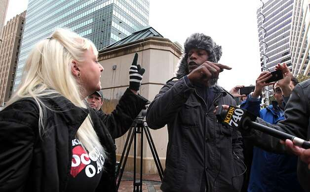 Khalid Shakur one of the original members of Occupy Oakland disagrees with a women who refused to give a name about last night's violence during a media conference by the media committee at Frank Ogawa Plaza Thursday, November 3, 2011 Photo: Lance Iversen, The Chronicle