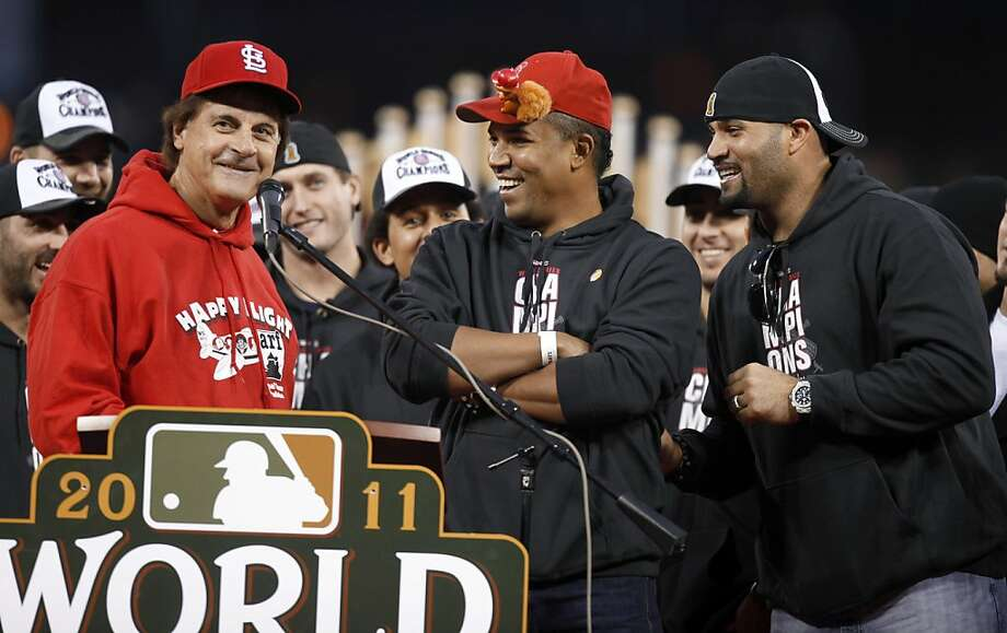 St. Louis Cardinals manager Tony La Russa, left, laughs with relief pitcher Octavio Dotel, center, Albert Pujols, right, and the rest of the team during a celebration of the baseball team's 11th World Series title, Sunday, Oct. 30, 2011, in St. Louis. (AP Photo/Jeff Roberson)  Ran on: 11-03-2011 Photo caption Dummy text goes here. Dummy text goes here. Dummy text goes here. Dummy text goes here. Dummy text goes here. Dummy text goes here. Dummy text goes here. Dummy text goes here.###Photo: names03_PHtony1319846400AP###Live Caption:St. Louis Cardinals manager Tony La Russa, left, laughs with relief pitcher Octavio Dotel, center, Albert Pujols, right, and the rest of the team during a celebration of the baseball team's 11th World Series title, Sunday, Oct. 30, 2011, in St. Louis.###Caption History:St. Louis Cardinals manager Tony La Russa, left, laughs with relief pitcher Octavio Dotel, center, Albert Pujols, right, and the rest of the team during a celebration of the baseball team's 11th World Series title, Sunday, Oct. 30, 2011, in St. Louis. (AP Photo-Jeff Roberson)###Notes:Tony La Russa, Octavio Dotel, Albert Pujols###Special Instructions: Photo: Jeff Roberson, AP