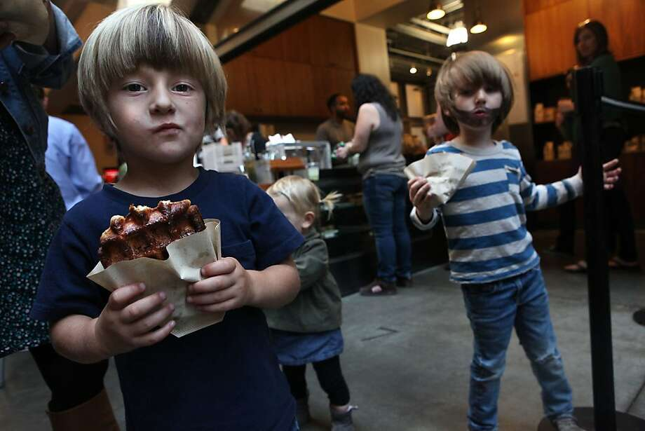 Francis Wraith (left), and Johnny Chandler (right), both from San Francisco and 4 years old, eating waffles from Blue Bottle Cafe at at the Ferry building in San Francisco, Calif., on Monday, November 1, 2011. Photo: Liz Hafalia, The Chronicle