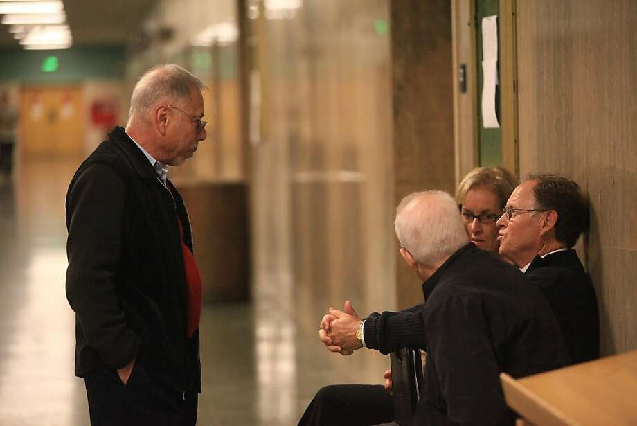 Former associate vice chancellor of City College of San Francisco Stephen Herman (left) and former City College of San Francisco Chancellor Philip Day (right) talk outside of Department 22 before being sentenced at the Hall of Justice on Tuesday, November 1, 2011 in San Francisco, Calif. Photo: Lea Suzuki, The Chronicle