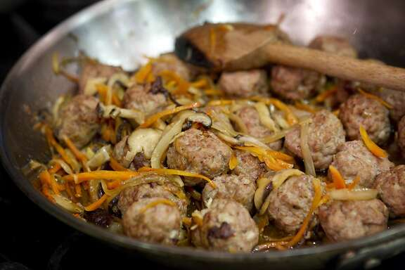 Ginger flavored meatballs made by Fumie Ito for the website Gobble cook on the stove in a commercial kitchen she rents in Pacifica, Calif., on May 16, 2011.  Gobble is an online marketplace for fresh food where users can order meals offered by individual chefs.