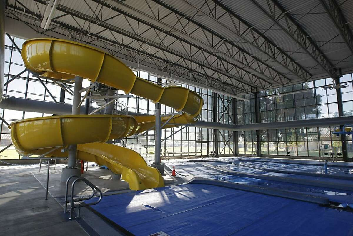 The pool area and water slide in the East Oakland Sports Center in Oakland, Calif., on Wednesday, Oct. 26, 2011.