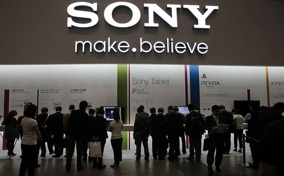 In this Oct. 4, 2011 photo, visitors crowd at the booth of Japanese entertainment and electronics giant Sony Corp. during an annual electronics show in Chiba, east of Tokyo. Sony is expected to post another quarterly loss when it reports results Wednesday, Nov. 2, 2011 as a strong yen and its struggling TV business drag on its bottomline. (AP Photo/Itsuo Inouye) Photo: Itsuo Inouye, AP