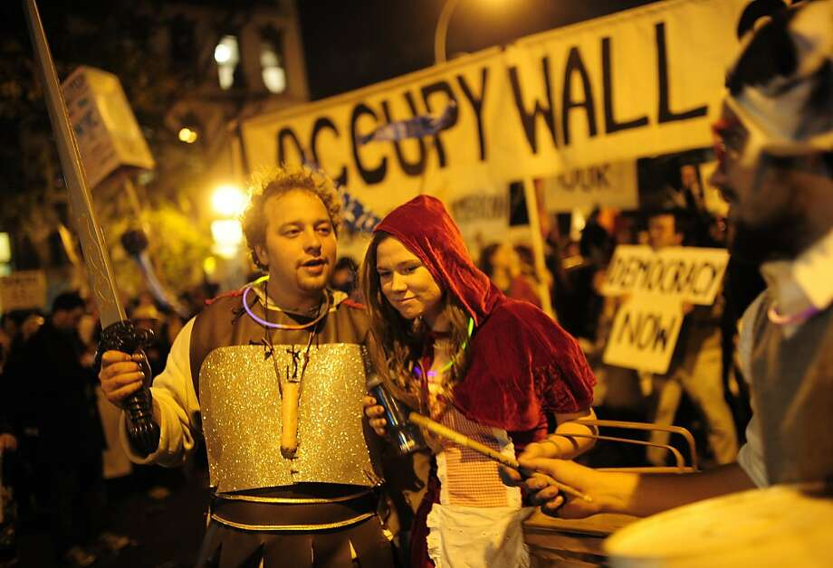 Occupy Wall Street members take part in New York's annual Halloween parade in New York, October 31, 2011. AFP PHOTO/Emmanuel Dunand (Photo credit should read EMMANUEL DUNAND/AFP/Getty Images) Photo: Emmanuel Dunand, AFP/Getty Images