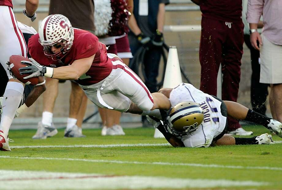 STANFORD, CA - OCTOBER 22:  Griff Whalen #17 of Stanford University dives but comes up a half yard short tackled by John Timu #10 of the Washington Huskies at Stanford Stadium on October 22, 2011 in Stanford, California.  (Photo by Thearon W. Henderson/Getty Images) Photo: Thearon W. Henderson, Getty Images
