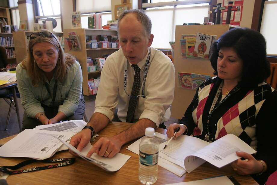 Principal Paul Jacobsen (C), Instructional Reform Facilitator Catherine Siemens, and Teacher Helen Karoukian analyze a first quarter Common Learning Assessment at Rosa Parks Elementary on Tuesday, Nov. 1, 2011, in San Francisco, Calif. Photo: Mathew Sumner, Special To The Chronicle