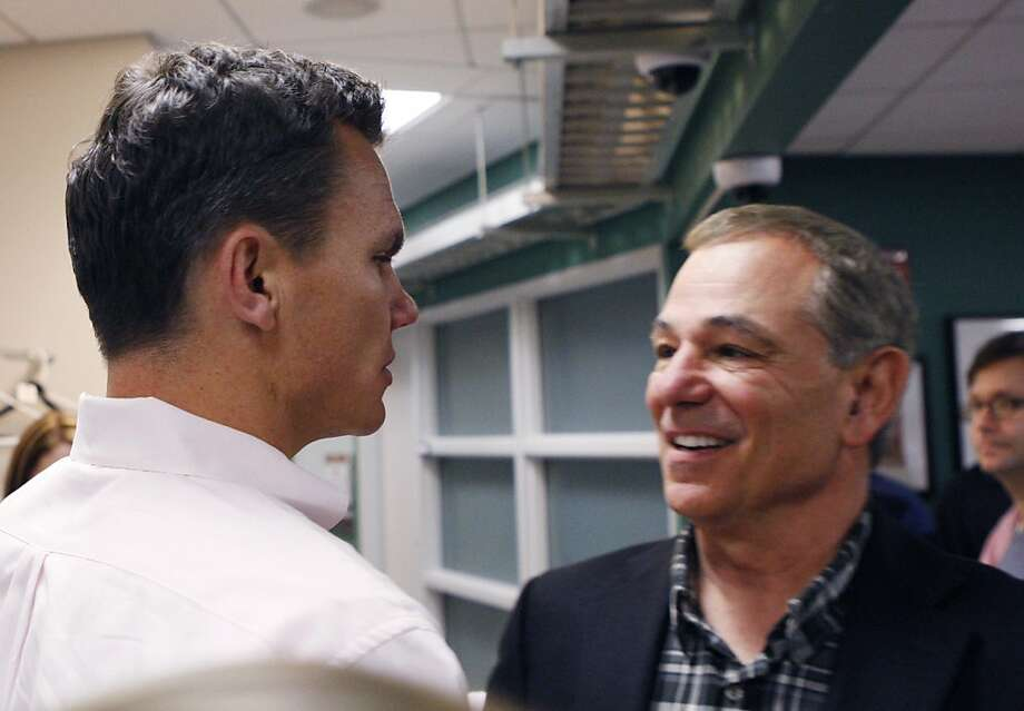 ESPN analyst Bobby Valentine, right, shakes hands with Boston Red Sox general manager Ben Cherington after a baseball availability following his interview for the vacant Boston Red Sox manager position at Fenway Park in Boston on Monday, Nov. 21, 2011.(AP Photo/Bizuayehu Tesfaye)  Ran on: 11-30-2011 Bobby Valentine (right) talks with Boston general manager Ben Cherington last week after interviewing for the job of Red Sox manager. Photo: Bizuayehu Tesfaye, AP