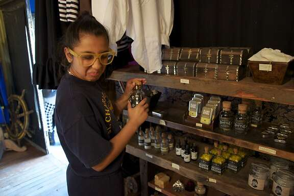 After-school tutoring student Veronica Suarez-Lopez takes in the complex aromas emanating from a bottle of Blackbeard's Beard Dye at the Pirate Store at 826 Valencia.