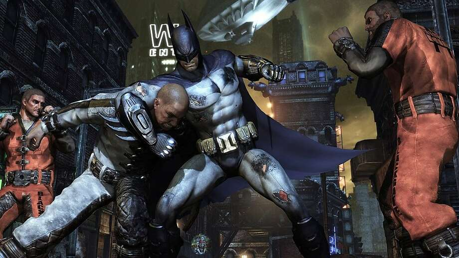 """In this video game image released by Rocksteady Studios/Warner Bros. Interactive Entertainment, a scene is shown from """"Batman: Arkham City."""" (AP Photo/Rocksteady Studios/Warner Bros. Interactive Entertainment)  Ran on: 11-03-2011 Hand-to-hand combat in this &quo;Batman&quo; is simple but satisfying, thanks to intricate animation. Photo: Warner Bros. Interactive Enterta, AP"""