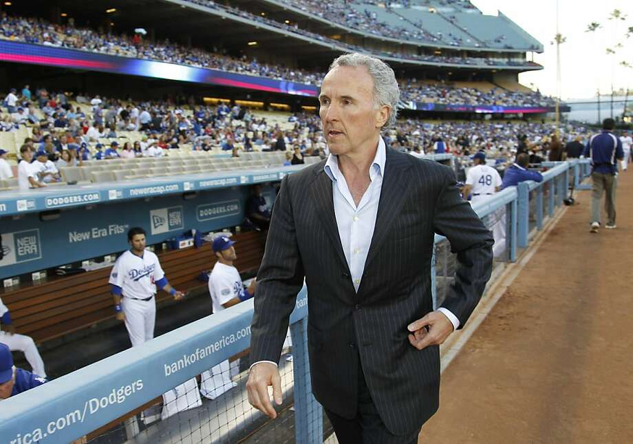 FILE - This June 8, 2010 file photo shows Frank McCourt walking by the dugout on the field before the Los Angeles Dodgers baseball game against the St. Louis Cardinals, in Los Angeles. The McCourt's have reached a divorce settlement that gives Frank McCourt control of the Dodgers and Jamie McCourt about $130 million, making it one of California's costliest divorces, according to a report published Monday, Oct. 17, 2011. (AP Photo/Danny Moloshok, File)  Ran on: 11-06-2011 Dodgers owner Frank McCourt ruined a once-proud franchise. His punishment? He's going to be paid a billion dollars. Ran on: 11-06-2011 Dodgers owner Frank McCourt ruined a once-proud franchise. His punishment? He's going to be paid a billion dollars. Photo: Danny Moloshok, AP