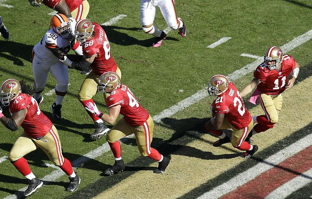 San Francisco 49ers running back Frank Gore (21) takes the handoff from quarterback Alex Smith (11) as he runs behind the blocking of guard Mike Iupati (77), offensive tackle Adam Snyder (68) and fullback Bruce Miller (49) against the Cleveland Browns in the first quarter of an NFL football game in San Francisco, Sunday, Oct. 30, 2011. (AP Photo/Ben Margot)