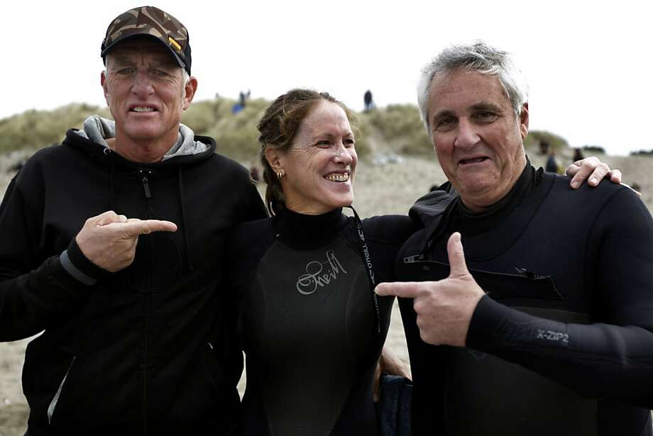 Bodysurfing veterans Mark Cunningham and Judith Sheridan meet with  Bruce Jenkins before facing off against each other in Heat 5 of a bodysurfing contest at Ocean Beach in San Francisco, Calif. on Saturday, Nov. 5, 2011. Photo: Paul Chinn, The Chronicle
