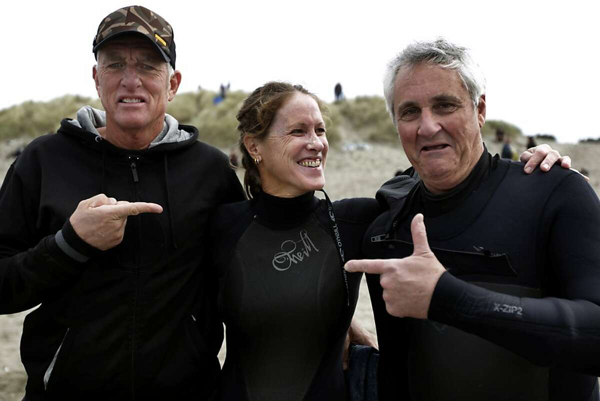 Bodysurfing veterans Mark Cunningham and Judith Sheridan meet with Bruce Jenkins before facing off against each other in Heat 5 of a bodysurfing contest at Ocean Beach in San Francisco, Calif. on Saturday, Nov. 5, 2011.