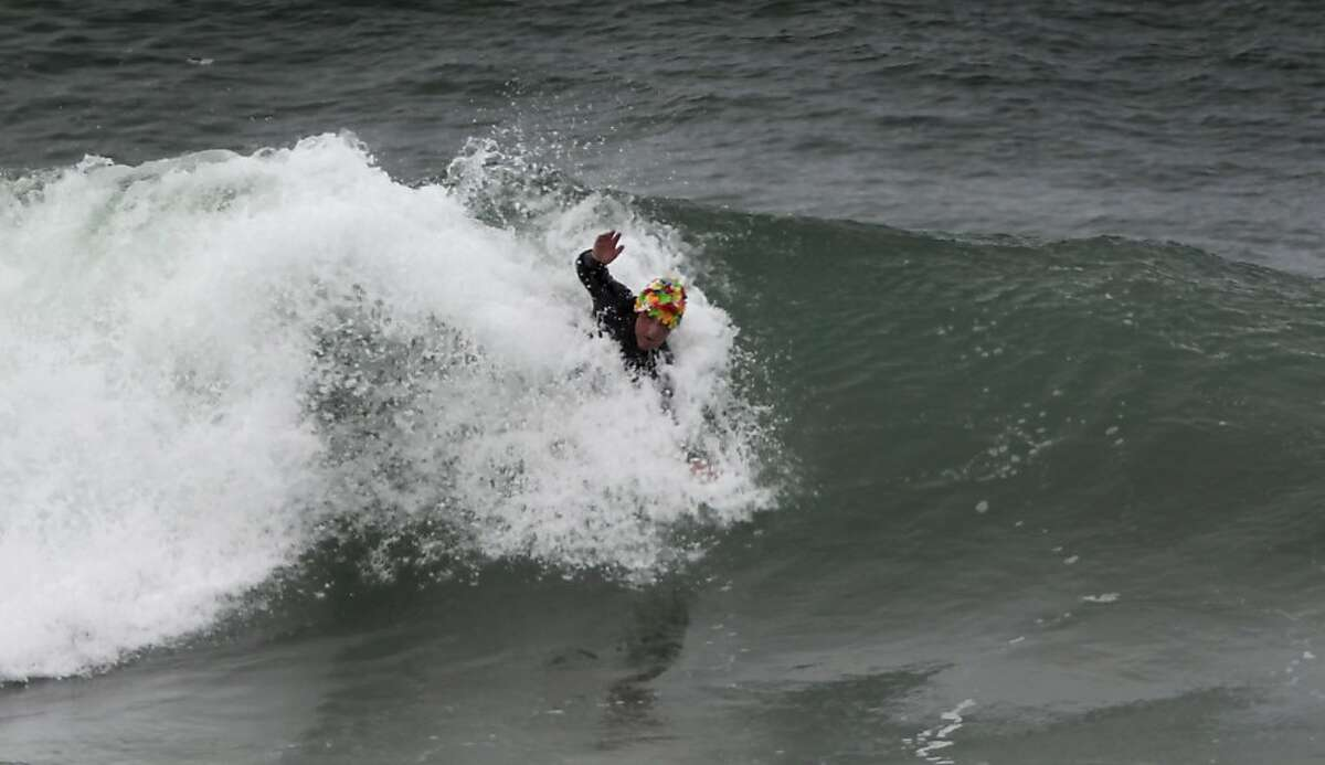 Bruce Jenkins competes in a bodysurfing contest at Ocean Beach in San Francisco, Calif. on Saturday, Nov. 5, 2011 on a day when the Rip Curl Pro Search surfing competition was delayed because of weather.