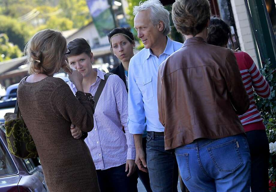 Fairfax Mayor Larry Bragman (right) and vice mayor Pam Hartwell-Herrero (center) walk down Bolinas Road in Fairfax small business district.  They are often asked by citizens about the upcoming tax vote. Fairfax (Marin County) is among dozens of cities asking voters for money on November 8 with a proposed sales tax to fix up and maintain city services and properties. Photo: Brant Ward, The Chronicle