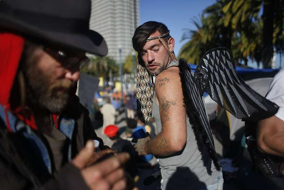Nick Shaw (right) checks out his wings while walking thorugh Occupy SF on Halloween morning at Justin Herman Plaza on Monday, October 31, 2011 in San Francisco, Calif. Photo: Lea Suzuki, The Chronicle