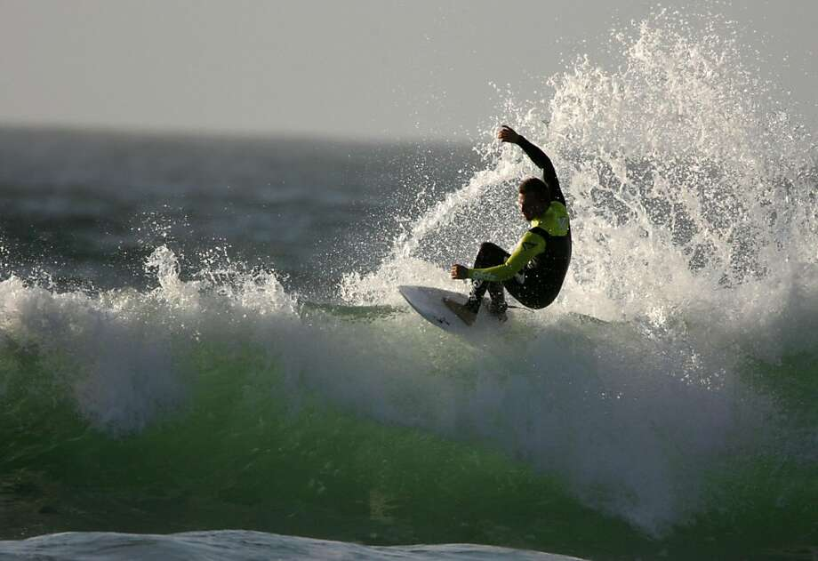 A surfer rides a wave at Ocean Beach on Monday, Oct. 31, 2011 in San Franicsco, Calif. Photo: Mathew Sumner, Special To The Chronicle
