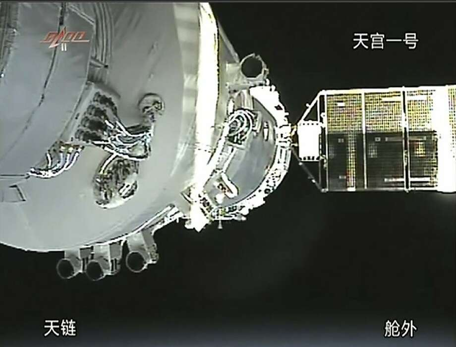 In this image taken from China's CCTV via APTN, a video image show the docking of the Shenzhou 8 craft that was launched Tuesday, Nov. 1, 2011 with the already orbiting Tiangong 1 module in the early morning of Thursday, Nov. 3, 2011. The  two unmanned Chinese spacecraft docked successfully and were orbiting the Earth together Thursday in a step that moves China closer to manning its own space station in about a decade. (AP Photo/CCTV via APTN) CHINA OUT, NO SALES, NO ARCHIVES, EDITORIAL USE ONLY Photo: Cctv, AP