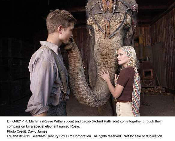 WATER FOR ELEPHANTS Marlena (Reese Witherspoon) and Jacob (Robert Pattinson) come together through their compassion for a special elephant named Rosie. Photo: David James, Twentieth Century Fox