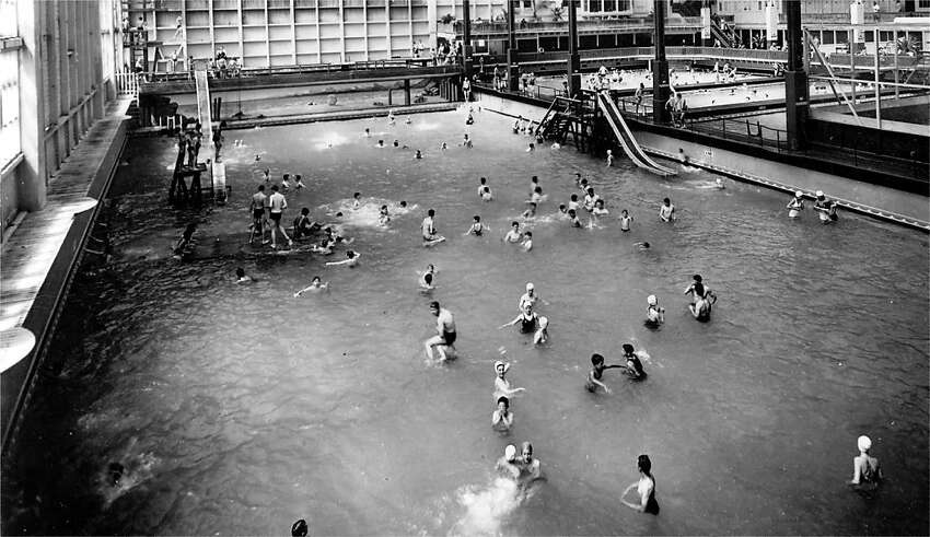 The largest of the Sutro Baths pools can be seen here, in a photo from the 1950s or early 1960s. The structure burned to the ground in 1966. The baths held up to 2 million gallons of ocean water, and were separated and heated to different temperatures.