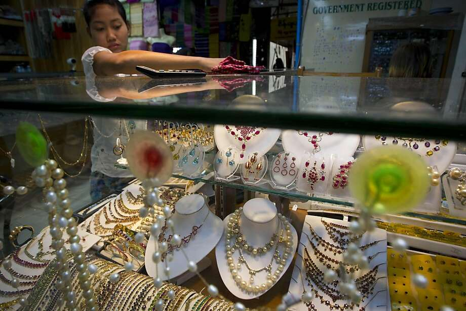 A worker cleans up a showcase of a jewelry shop at Aung San Market in downtown Yangon, Myanmar, Tuesday, Nov. 29, 2011. (AP Photo/Vincent Thian) Photo: Vincent Thian, AP