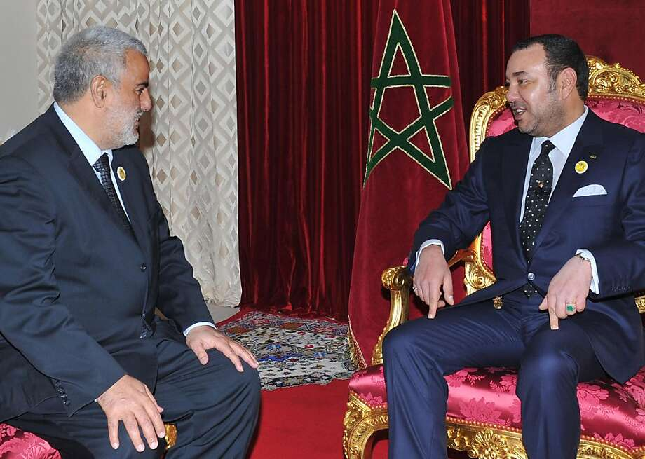 The general-secretary of the Justice and Development Party (PJD), Abdelilah Benkirane (L), meets with Morocco's King Mohammed VI on November 29, 2011 in Midelt. The king on November 29 named Benkirane as prime minister after his Islamist party's victory in the November 25 elections. AFP PHOTO /AZZOUZ BOUKALLOUCH (Photo credit should read AZZOUZ BOUKALLOUCH/AFP/Getty Images) Photo: Azzouz Boukallouch, AFP/Getty Images