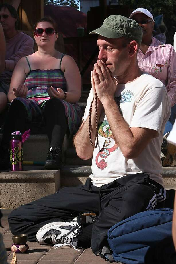 Joe Weston, from Oakland, joined part of the noon meditation group initiated by the Buddhist Peace Meditation Fellowship at Occupy Oakland in Frank Ogawa Plaza in Oakland, Calif., on Monday, October 31, 2011.  He said he will be meditating from 8am to 8pm on Wednesday during the strike out. Photo: Liz Hafalia, The Chronicle