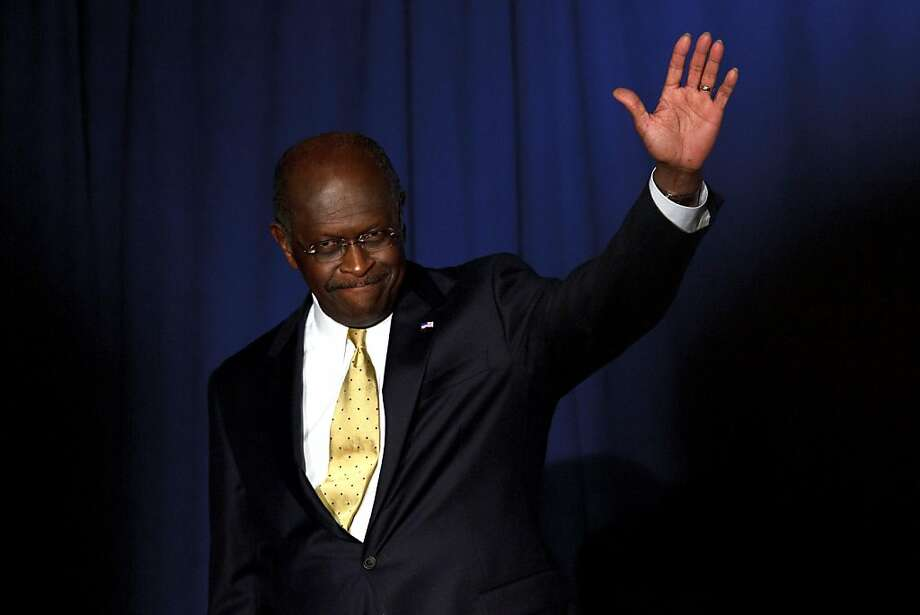 """Republican presidential candidate Herman Cain waves to the crowd at Hillsdale College in Hillsdale, Mich., Tuesday, Nov. 29, 2011. Cain told aides earlier in the day on Tuesday he is assessing whether the latest allegations of inappropriate sexual behavior against him """"create too much of a cloud"""" for his Republican presidential candidacy to go forward. (AP Photo/Rick Osentoski) Photo: Rick Osentoski, AP"""