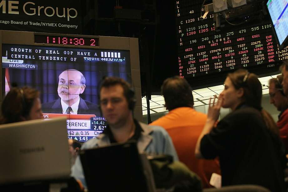 CHICAGO, IL - NOVEMBER 02:  A monitor above the trading floor of the CME Group displays a press conference with Fed Chairman Ben Bernanke on November 2, 2011 in Chicago, Illinois. Bernanke held his news conference following the Federal Reserve's policy announcement that interest rates would remain unchanged.  (Photo by Scott Olson/Getty Images) Photo: Scott Olson, Getty Images