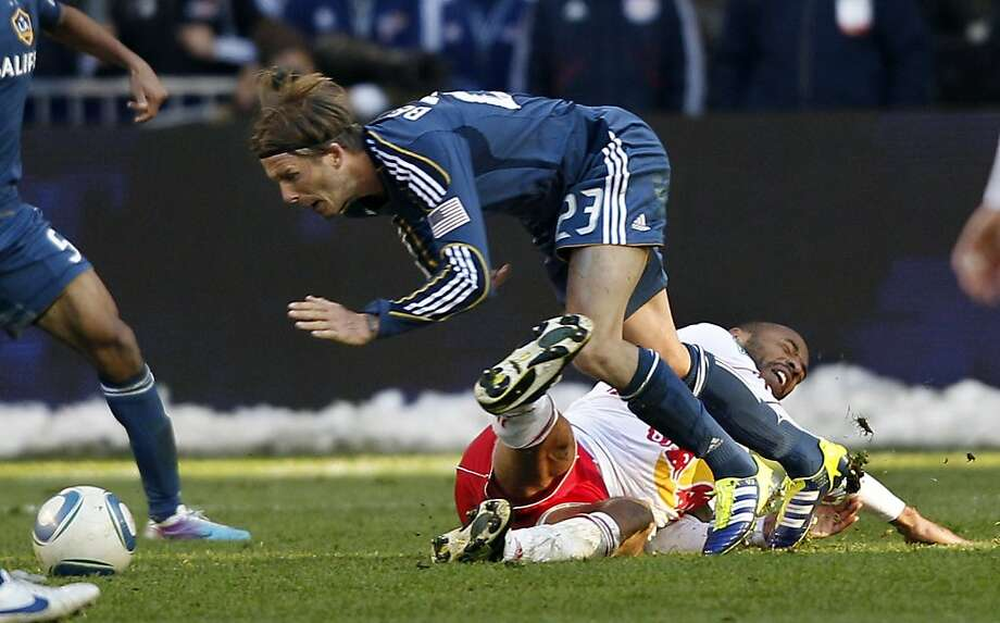 New York Red Bulls forward Thierry Henry, bottom, of France, collides with Los Angeles Galaxy midfielder David Beckham, of England, late in the second period of an MLS soccer match Sunday, Oct. 30, 2011, Newark, N.J. Galaxy won 1-0. (AP Photo/Mel Evans) Photo: Mel Evans, AP