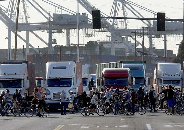 Bicyclists were the first to block trucks trying to leave the port. Thousands of OccupyOakland supporters left their downtown protest for the Port of Oakland where they met little resistance early in the evening Wednesday November 2, 2011. They essentially shut it down by blocking entrances at the port. Photo: Brant Ward, The Chronicle