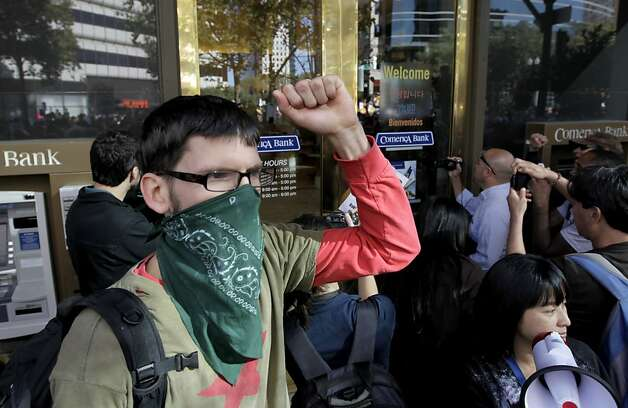 Occupy Oakland protesters temporarily shut down a Comerica Bank branch at 12th and Brodway streets during a general strike in Oakland, Calif. on Wednesday, Nov. 3, 2011. Photo: Paul Chinn, The Chronicle
